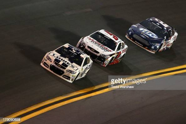 Jimmie Johnson driver of the Lowe's Dover White Chevrolet races Kasey Kahne driver of the Hendrickcarscom Chevrolet and Brad Keselowski driver of the...