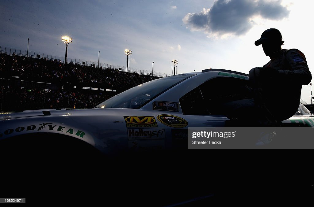 Jimmie Johnson, driver of the #48 Lowe's Emerald Green Chevrolet, climbs out of his car during qualifying for the NASCAR Sprint Cup Series Bojangles' Southern 500 at Darlington Raceway on May 10, 2013 in Darlington, South Carolina.