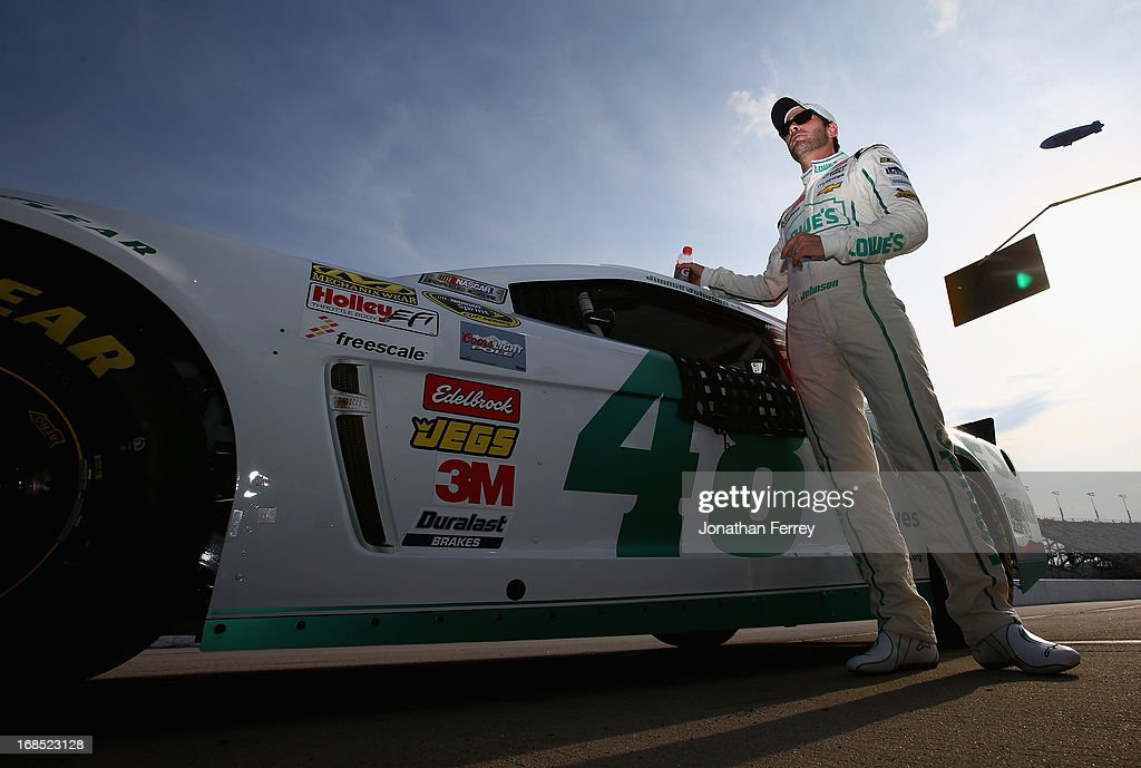 Jimmie Johnson, driver of the #48 Lowe's Emerald Green Chevrolet, stands by his car during qualifying for the NASCAR Sprint Cup Series Bojangles' Southern 500 at Darlington Raceway on May 10, 2013 in Darlington, South Carolina.