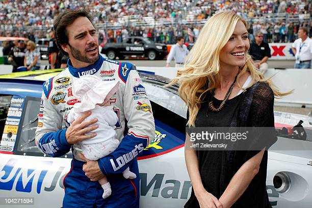 Jimmie Johnson driver of the Lowe's / Johns Manville Chevrolet holds his baby daughter Genevieve Marie as his wife Chandra looks on from the grid...