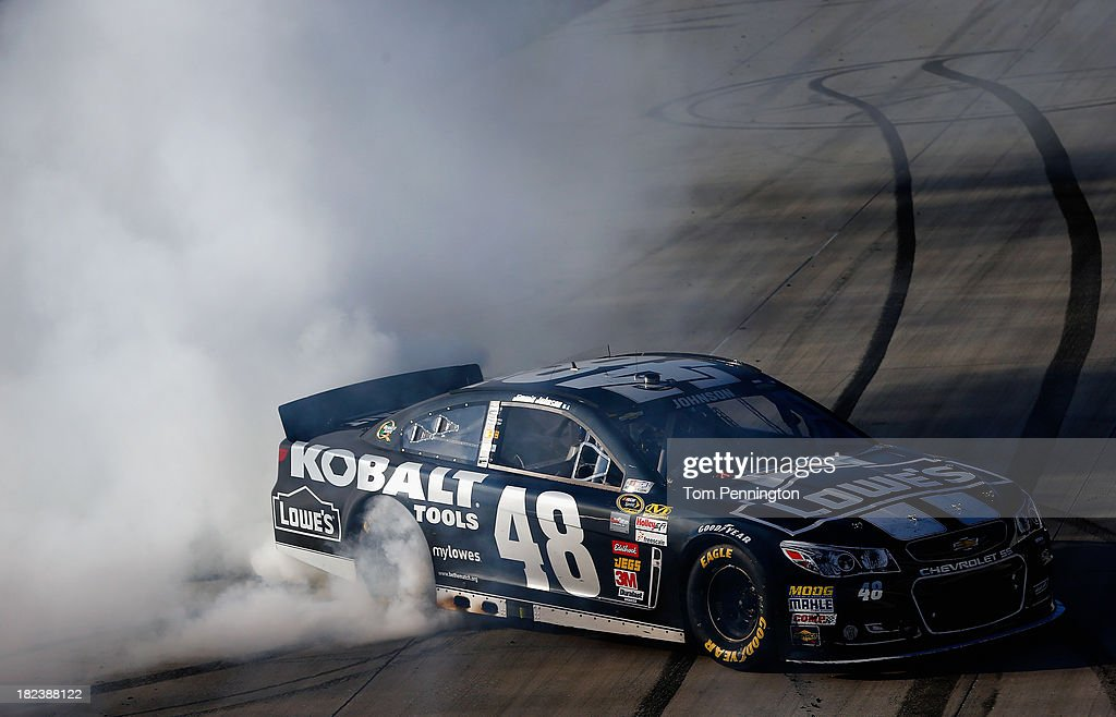Jimmie Johnson, driver of the #48 Lowe's / Kobalt Tools Chevrolet, celebrates with a burnout after winning the NASCAR Sprint Cup Series AAA 400 at Dover International Speedway on September 29, 2013 in Dover, Delaware.