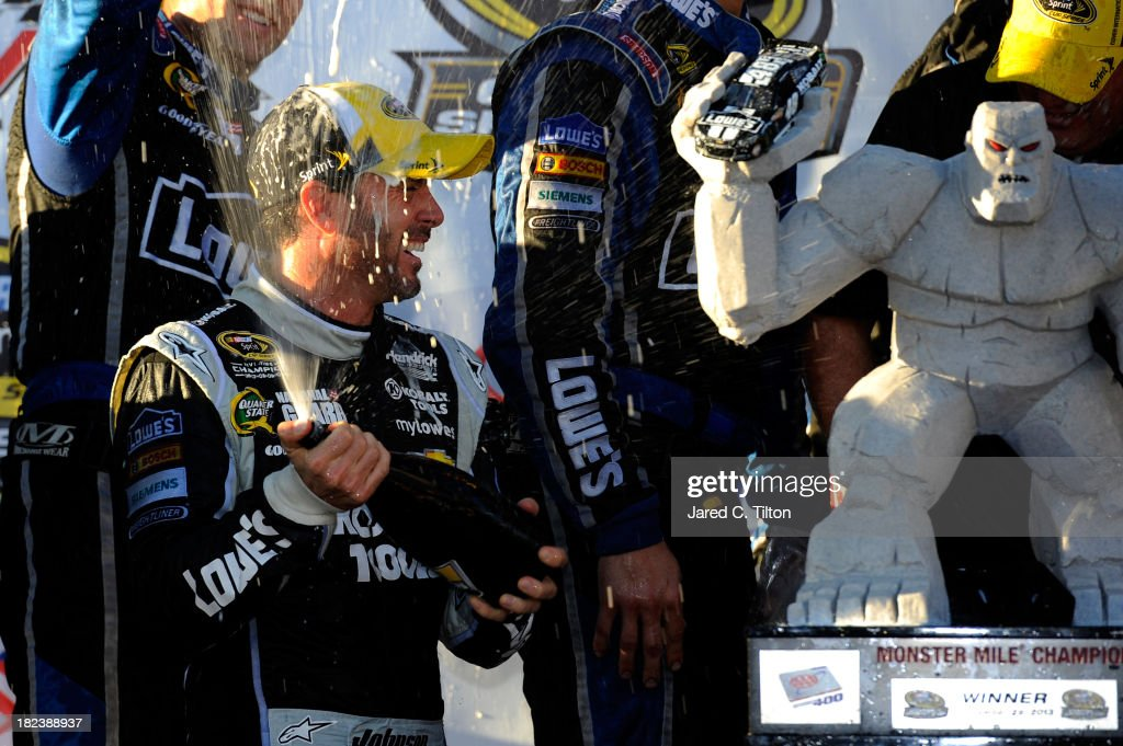 Jimmie Johnson, driver of the #48 Lowe's / Kobalt Tools Chevrolet, celebrates in Victory Lane with champagne after winning during the NASCAR Sprint Cup Series AAA 400 at Dover International Speedway on September 29, 2013 in Dover, Delaware.