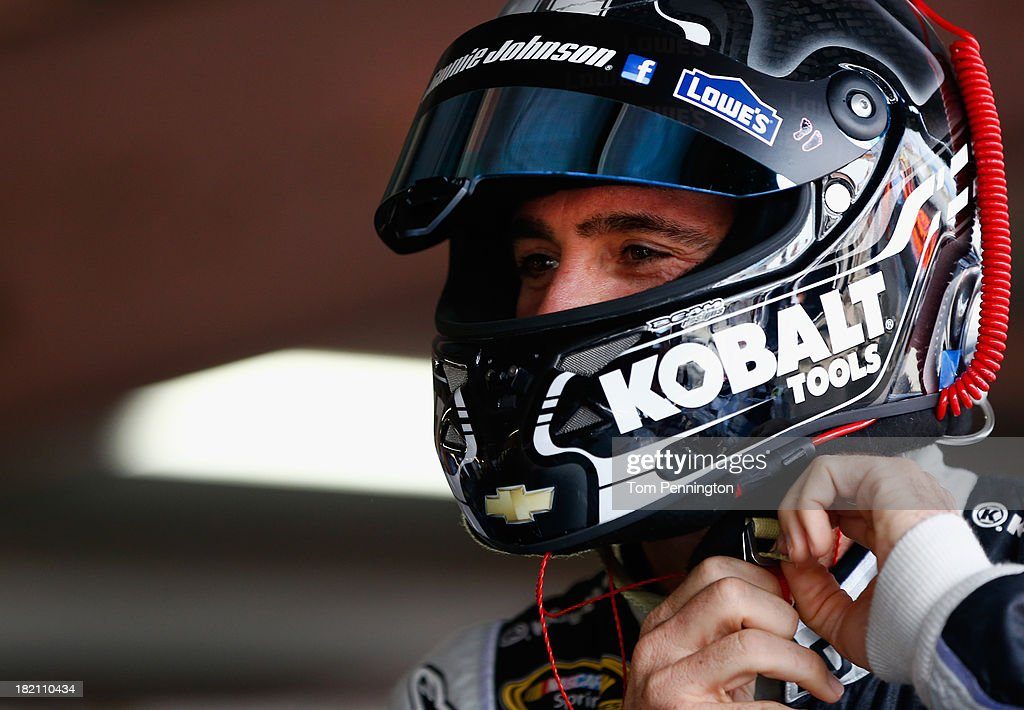 Jimmie Johnson, driver of the #48 Lowe's / Kobalt Tools Chevrolet, prepares his helmet in the garage area during practice for the NASCAR Sprint Cup Series AAA 400 at Dover International Speedway on September 28, 2013 in Dover, Delaware.