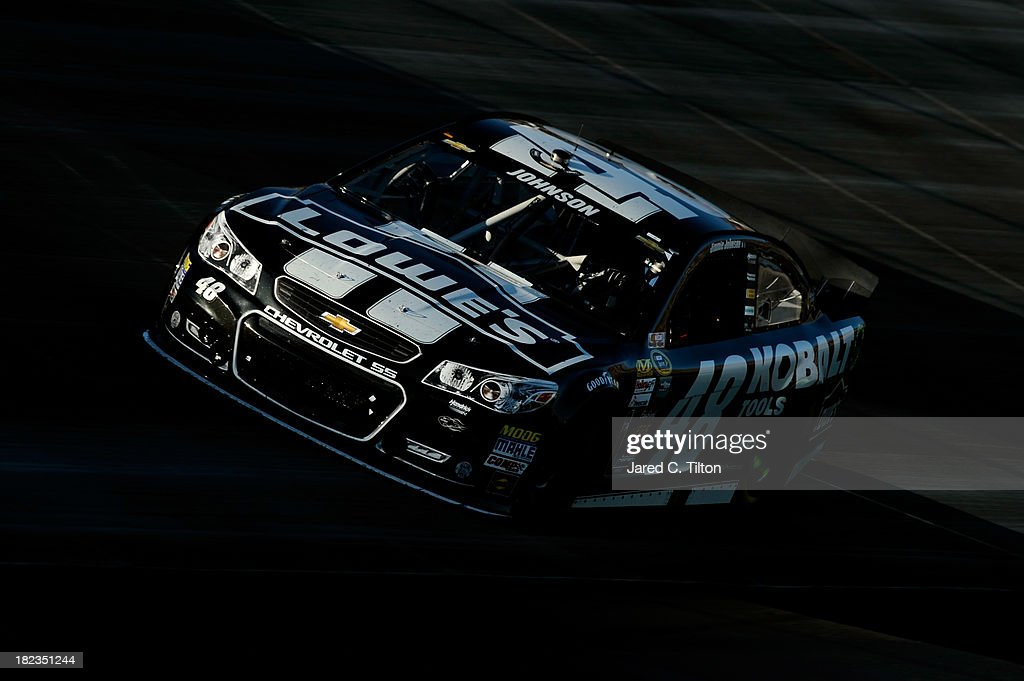 Jimmie Johnson, driver of the #48 Lowe's / Kobalt Tools Chevrolet, races the NASCAR Sprint Cup Series AAA 400 at Dover International Speedway on September 29, 2013 in Dover, Delaware.