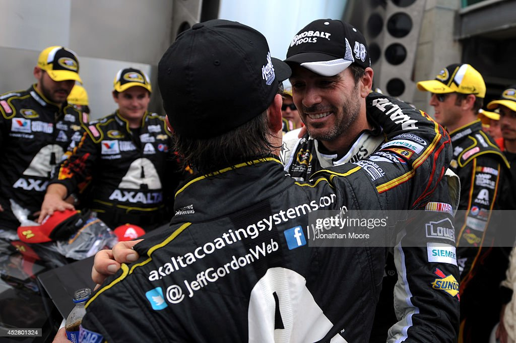 Jimmie Johnson, driver of the #48 Lowe's / Kobalt Tools Chevrolet, right, congratulates Jeff Gordon, driver of the #24 Axalta Chevrolet, left on Gordon's winning the NASCAR Sprint Cup Series Crown Royal Presents The John Wayne Walding 400 at the Brickyard Indianapolis Motor Speedway on July 27, 2014 in Indianapolis, Indiana.