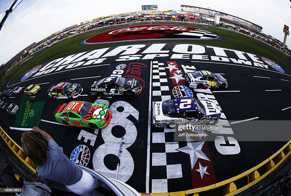 Jimmie Johnson, driver of the #48 Lowe's Patriotic Chevrolet, and Brad Keselowski, driver of the #2 Miller Lite Ford, lead the field past the green flag to start the NASCAR Sprint Cup Series Coca-Cola 600 at Charlotte Motor Speedway on May 25, 2014 in Charlotte, North Carolina.
