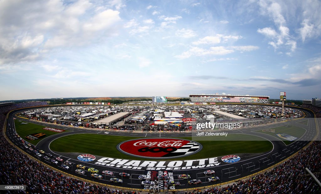 Jimmie Johnson, driver of the #48 Lowe's Patriotic Chevrolet, and Brad Keselowski, driver of the #2 Miller Lite Ford, lead the field on the first lap of the NASCAR Sprint Cup Series Coca-Cola 600 at Charlotte Motor Speedway on May 25, 2014 in Charlotte, North Carolina.