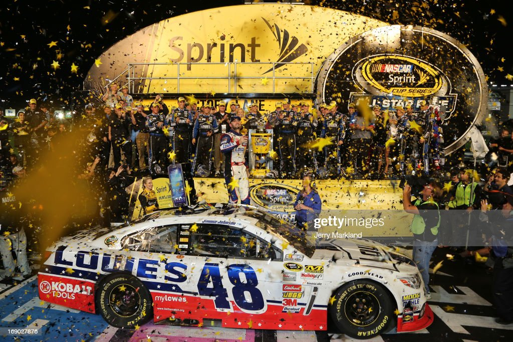 <a gi-track='captionPersonalityLinkClicked' href=/galleries/search?phrase=Jimmie+Johnson+-+Pilote+de+Nascar&family=editorial&specificpeople=171519 ng-click='$event.stopPropagation()'>Jimmie Johnson</a>, driver of the #48 Lowe's Patriotic Chevrolet, celebrates in Victory Lane after winning the NASCAR Sprint Cup Series All-Star race at Charlotte Motor Speedway on May 18, 2013 in Concord, North Carolina.