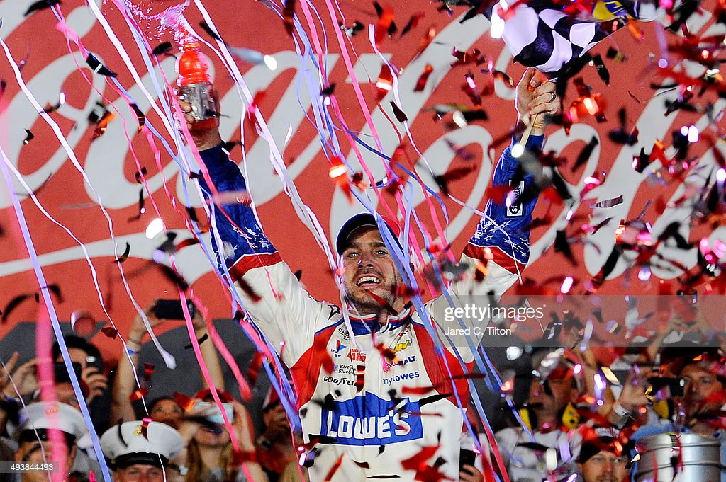 Jimmie Johnson, driver of the #48 Lowe's Patriotic Chevrolet, celebrates in victory lane after winning the NASCAR Sprint Cup Series Coca-Cola 600 at Charlotte Motor Speedway on May 25, 2014 in Charlotte, North Carolina.