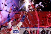 Jimmie Johnson driver of the Lowe's Patriotic Chevrolet celebrates in victory lane after winning the NASCAR Sprint Cup Series CocaCola 600 at...