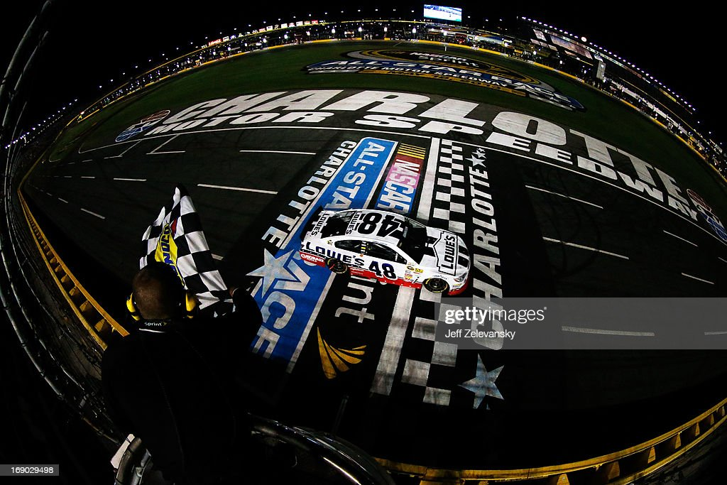 Jimmie Johnson, driver of the #48 Lowe's Patriotic Chevrolet, crosses the finishline to win the NASCAR Sprint Cup Series All-Star race at Charlotte Motor Speedway on May 18, 2013 in Concord, North Carolina.