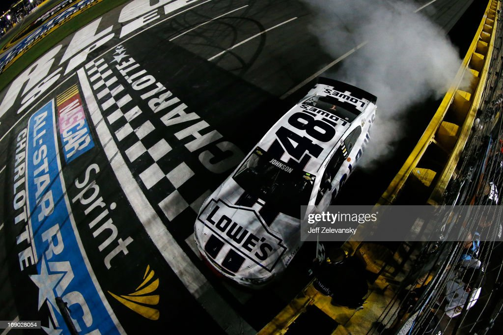 Jimmie Johnson, driver of the #48 Lowe's Patriotic Chevrolet, performs a burnout to celebrate winning the NASCAR Sprint Cup Series All-Star race at Charlotte Motor Speedway on May 18, 2013 in Concord, North Carolina.