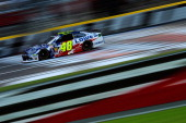 Jimmie Johnson driver of the Lowe's Patriotic Chevrolet qualifies for the NASCAR Sprint Cup Series CocaCola 600 at Charlotte Motor Speedway on May 22...