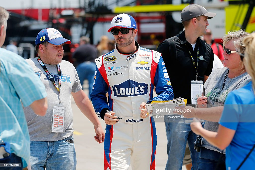 <a gi-track='captionPersonalityLinkClicked' href=/galleries/search?phrase=Jimmie+Johnson+-+Nascar+Race+Driver&family=editorial&specificpeople=171519 ng-click='$event.stopPropagation()'>Jimmie Johnson</a>, driver of the #48 Lowe's Patriotic Chevrolet, signs autographs during practice for the NASCAR Sprint Cup Series Coca-Cola 600 at Charlotte Motor Speedway on May 27, 2016 in Charlotte, North Carolina.