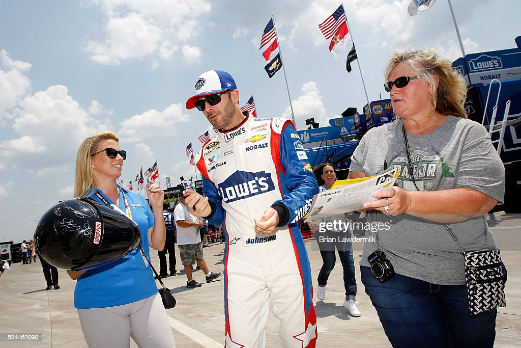 <a gi-track='captionPersonalityLinkClicked' href=/galleries/search?phrase=Jimmie+Johnson+-+Nascar+Race+Driver&family=editorial&specificpeople=171519 ng-click='$event.stopPropagation()'>Jimmie Johnson</a>, driver of the #48 Lowe's Patriotic Chevrolet, signs autographs for fans during practice for the NASCAR Sprint Cup Series Coca-Cola 600 at Charlotte Motor Speedway on May 27, 2016 in Charlotte, North Carolina.