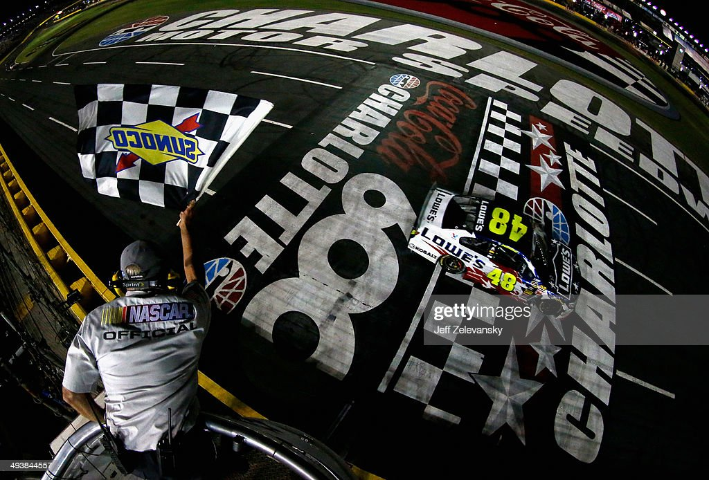Jimmie Johnson, driver of the #48 Lowe's Patriotic Chevrolet, takes the checkered flag to win the NASCAR Sprint Cup Series Coca-Cola 600 at Charlotte Motor Speedway on May 25, 2014 in Charlotte, North Carolina.