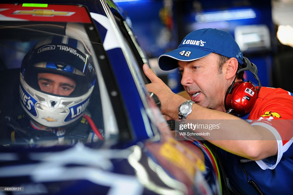 Jimmie Johnson, driver of the #48 Lowe's Patriotic Chevrolet, talks to his crew chief, Chad Knaus, during practice for the NASCAR Sprint Cup Series Coca-Cola 600 at Charlotte Motor Speedway on May 24, 2014 in Charlotte, North Carolina.