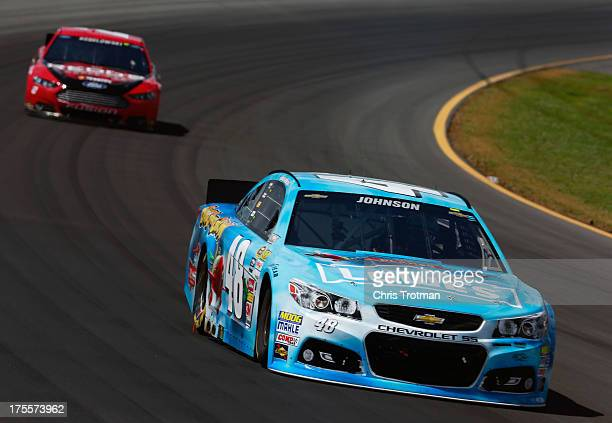 Jimmie Johnson driver of the Lowe's Planes Chevrolet leads Brad Keselowski driver of the Redd's Apple Ale Ford during the NASCAR Sprint Cup Series...