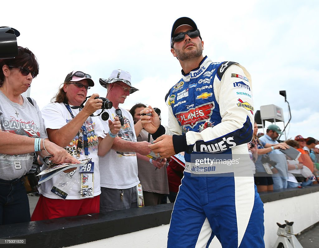 <a gi-track='captionPersonalityLinkClicked' href=/galleries/search?phrase=Jimmie+Johnson+-+Nascar+Race+Driver&family=editorial&specificpeople=171519 ng-click='$event.stopPropagation()'>Jimmie Johnson</a>, driver of the #48 Lowe's Planes Chevrolet, signs autographs before qualifying for the NASCAR Sprint Cup Series GoBowling.com 400 at Pocono Raceway on August 2, 2013 in Long Pond, Pennsylvania.
