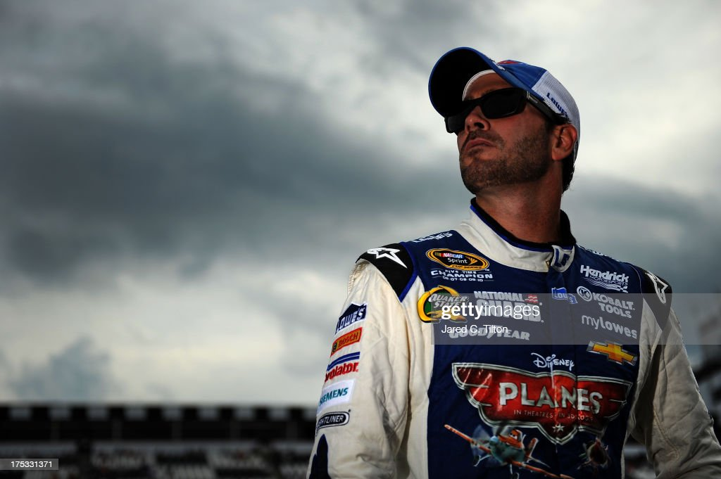 <a gi-track='captionPersonalityLinkClicked' href=/galleries/search?phrase=Jimmie+Johnson+-+Nascar+Race+Driver&family=editorial&specificpeople=171519 ng-click='$event.stopPropagation()'>Jimmie Johnson</a>, driver of the #48 Lowe's Planes Chevrolet, stands on the grid after qualifying on the pole for the NASCAR Sprint Cup Series GoBowling.com 400 at Pocono Raceway on August 2, 2013 in Long Pond, Pennsylvania.