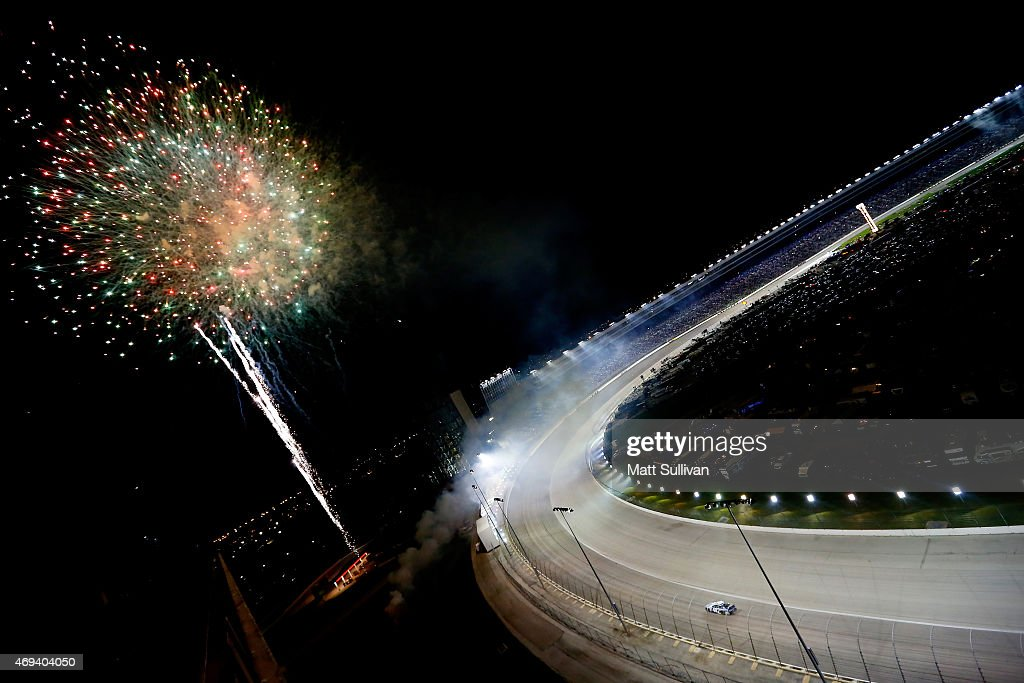 <a gi-track='captionPersonalityLinkClicked' href=/galleries/search?phrase=Jimmie+Johnson+-+Nascar+racerf%C3%B6rare&family=editorial&specificpeople=171519 ng-click='$event.stopPropagation()'>Jimmie Johnson</a>, driver of the #48 Lowe's Pro Services Chevrolet, cebelrates with a parade lap after winning the NASCAR Sprint Cup Series Duck Commander 500 at Texas Motor Speedway on April 11, 2015 in Fort Worth, Texas.