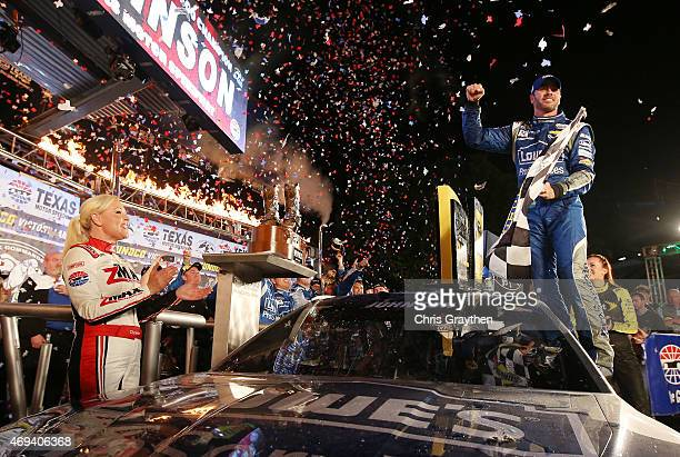 Jimmie Johnson driver of the Lowe's Pro Services Chevrolet celebrates in Victory Lane after winning the NASCAR Sprint Cup Series Duck Commander 500...