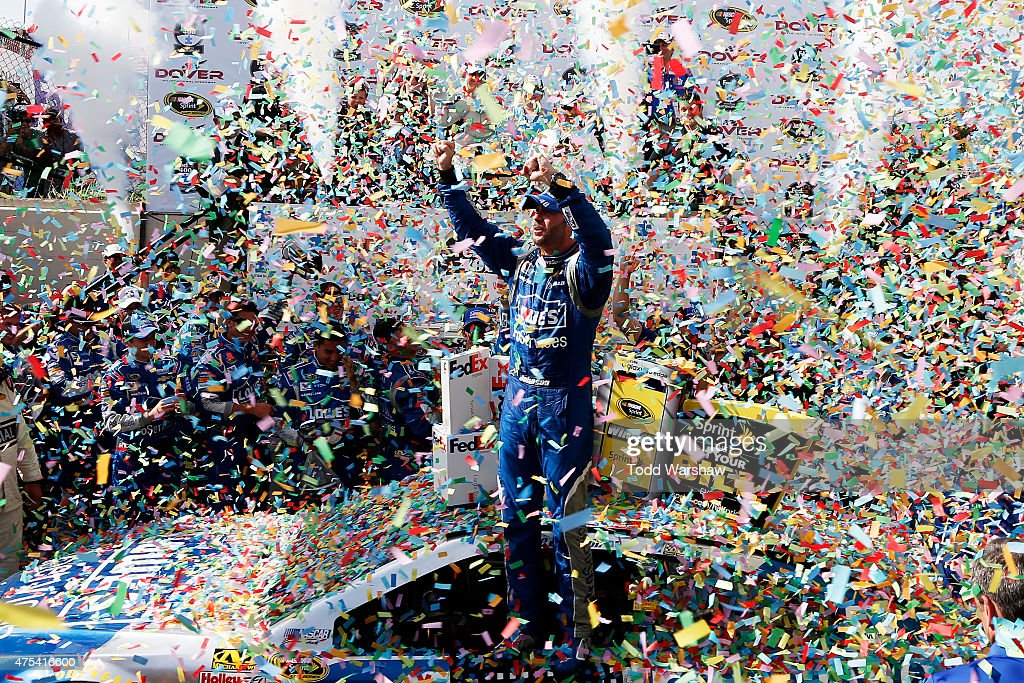 Jimmie Johnson, driver of the #48 Lowe's Pro Services Chevrolet, celebrates in Victory Lane after winning the NASCAR Sprint Cup Series FedEx 400 Benefiting Autism Speaks at Dover International Speedway on May 31, 2015 in Dover, Delaware.