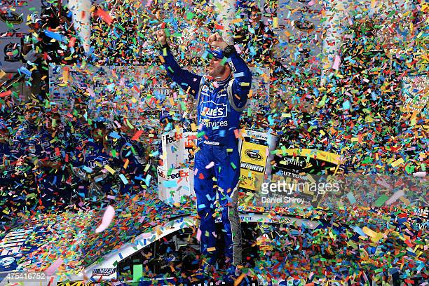 Jimmie Johnson driver of the Lowe's Pro Services Chevrolet celebrates in Victory Lane after winning the NASCAR Sprint Cup Series FedEx 400 Benefiting...