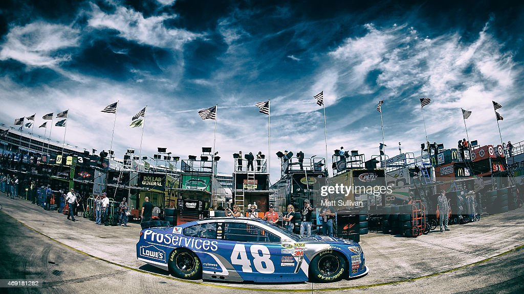 <a gi-track='captionPersonalityLinkClicked' href=/galleries/search?phrase=Jimmie+Johnson+-+Piloto+da+Nascar&family=editorial&specificpeople=171519 ng-click='$event.stopPropagation()'>Jimmie Johnson</a>, driver of the #48 Lowe's Pro Services Chevrolet, drives through the garage area during practice for the NASCAR Sprint Cup Series Duck Commander 500 at Texas Motor Speedway on April 10, 2015 in Fort Worth, Texas.