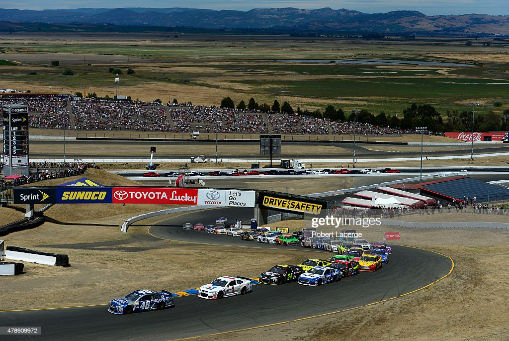 Jimmie Johnson driver of the Lowe's Pro Services Chevrolet leads a pack of cars during the NASCAR Sprint Cup Series Toyota/Save Mart 350 at Sonoma...