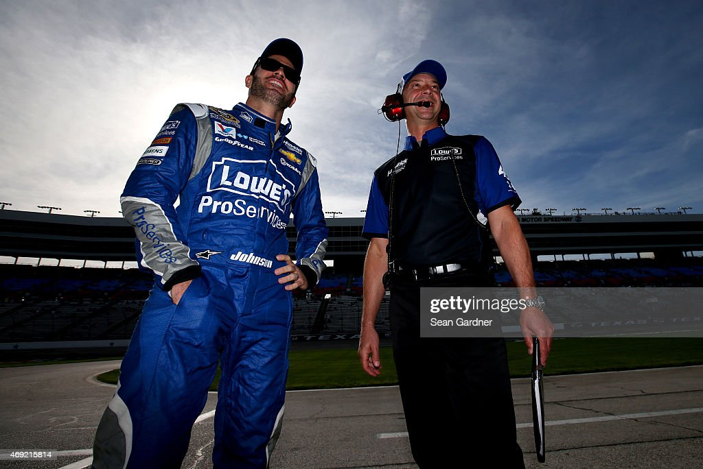 <a gi-track='captionPersonalityLinkClicked' href=/galleries/search?phrase=Jimmie+Johnson+-+Nascar+racerf%C3%B6rare&family=editorial&specificpeople=171519 ng-click='$event.stopPropagation()'>Jimmie Johnson</a>, driver of the #48 Lowe's Pro Services Chevrolet, left and crew chief <a gi-track='captionPersonalityLinkClicked' href=/galleries/search?phrase=Chad+Knaus&family=editorial&specificpeople=564401 ng-click='$event.stopPropagation()'>Chad Knaus</a> looks on from the grid during qualifying for the NASCAR Sprint Cup Series Duck Commander 500 at Texas Motor Speedway on April 10, 2015 in Fort Worth, Texas.