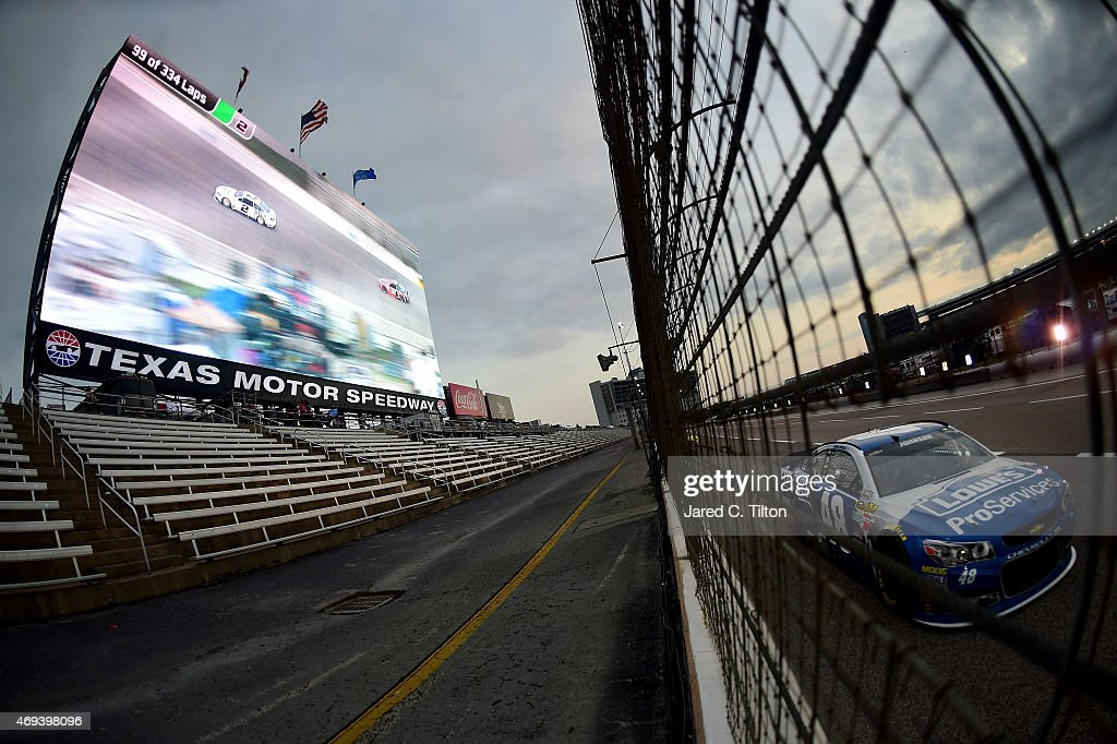 <a gi-track='captionPersonalityLinkClicked' href=/galleries/search?phrase=Jimmie+Johnson+-+Nascar+Race+Driver&family=editorial&specificpeople=171519 ng-click='$event.stopPropagation()'>Jimmie Johnson</a>, driver of the #48 Lowe's Pro Services Chevrolet, races the NASCAR Sprint Cup Series Duck Commander 500 at Texas Motor Speedway on April 11, 2015 in Fort Worth, Texas.