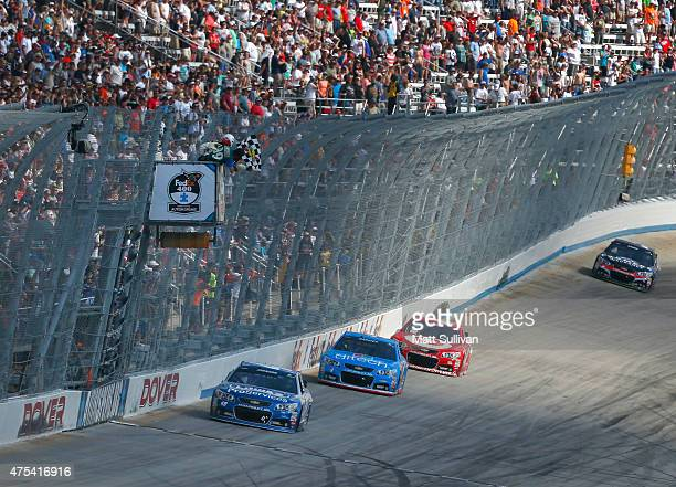 Jimmie Johnson driver of the Lowe's Pro Services Chevrolet races to the finish line to win the NASCAR Sprint Cup Series FedEx 400 Benefiting Autism...