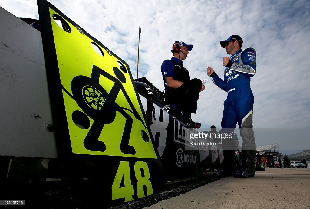 <a gi-track='captionPersonalityLinkClicked' href=/galleries/search?phrase=Jimmie+Johnson+-+Piloto+da+Nascar&family=editorial&specificpeople=171519 ng-click='$event.stopPropagation()'>Jimmie Johnson</a>, driver of the #48 Lowe's Pro Services Chevrolet, right, talks with crew chief <a gi-track='captionPersonalityLinkClicked' href=/galleries/search?phrase=Chad+Knaus&family=editorial&specificpeople=564401 ng-click='$event.stopPropagation()'>Chad Knaus</a> on the grid during qualifying for the NASCAR Sprint Cup Series FedEx 400 Benefiting Autism Speaks at Dover International Speedway on May 29, 2015 in Dover, Delaware.