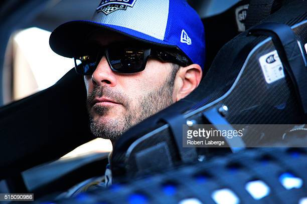 Jimmie Johnson driver of the Lowe's Pro Services Chevrolet sits in his car during practice for the NASCAR Sprint Cup Series Good Sam 500 at Phoenix...