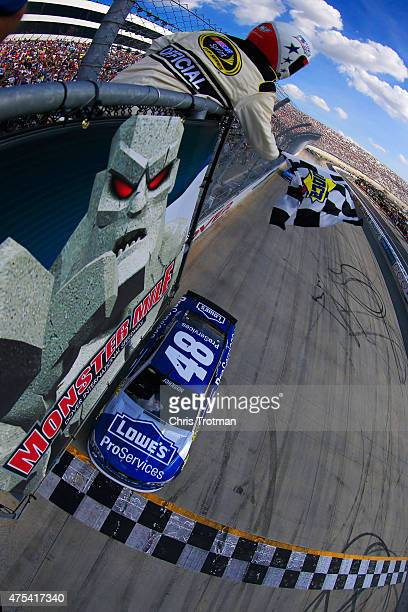 Jimmie Johnson driver of the Lowe's Pro Services Chevrolet takes the checkered flag to win the NASCAR Sprint Cup Series FedEx 400 Benefiting Autism...