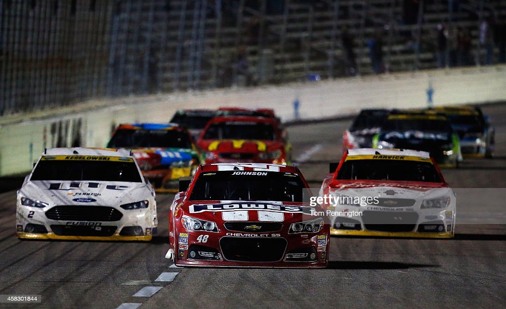 <a gi-track='captionPersonalityLinkClicked' href=/galleries/search?phrase=Jimmie+Johnson+-+Nascar+Race+Driver&family=editorial&specificpeople=171519 ng-click='$event.stopPropagation()'>Jimmie Johnson</a>, driver of the #48 Lowe's Red Vest Chevrolet, races ahead of <a gi-track='captionPersonalityLinkClicked' href=/galleries/search?phrase=Brad+Keselowski&family=editorial&specificpeople=890258 ng-click='$event.stopPropagation()'>Brad Keselowski</a>, driver of the #2 Miller Lite Ford, and <a gi-track='captionPersonalityLinkClicked' href=/galleries/search?phrase=Kevin+Harvick&family=editorial&specificpeople=209186 ng-click='$event.stopPropagation()'>Kevin Harvick</a>, driver of the #4 Budweiser Chevrolet, during the NASCAR Sprint Cup Series AAA Texas 500 at Texas Motor Speedway on November 2, 2014 in Fort Worth, Texas.