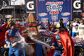 Jimmie Johnson driver of the Lowe's / Superman Chevrolet celebrates in victory lane with crew chief Chad Knaus after winning the NASCAR Sprint Cup...
