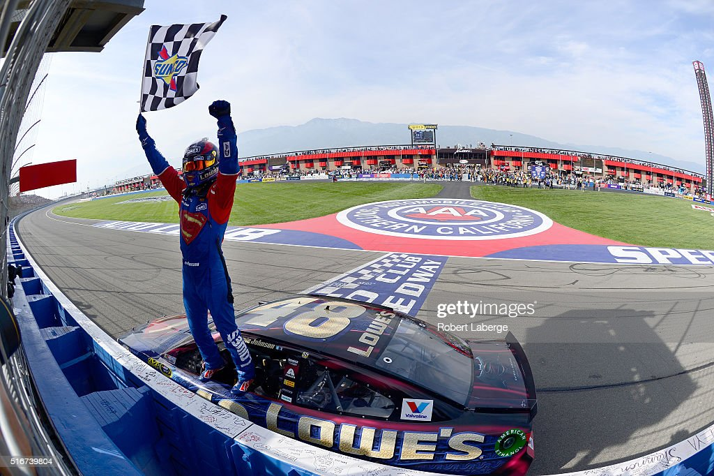 Jimmie Johnson, driver of the #48 Lowe's / Superman Chevrolet, celebrates after taking the checkered flag during the NASCAR Sprint Cup Series Auto Club 400 at Auto Club Speedway on March 20, 2016 in Fontana, California.
