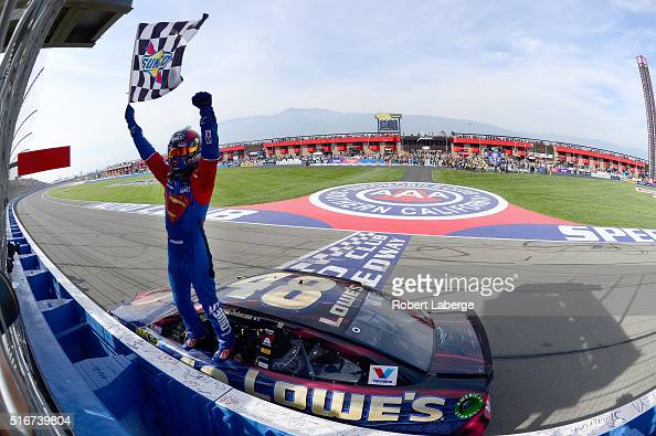 Jimmie Johnson driver of the Lowe's / Superman Chevrolet celebrates after taking the checkered flag during the NASCAR Sprint Cup Series Auto Club 400...