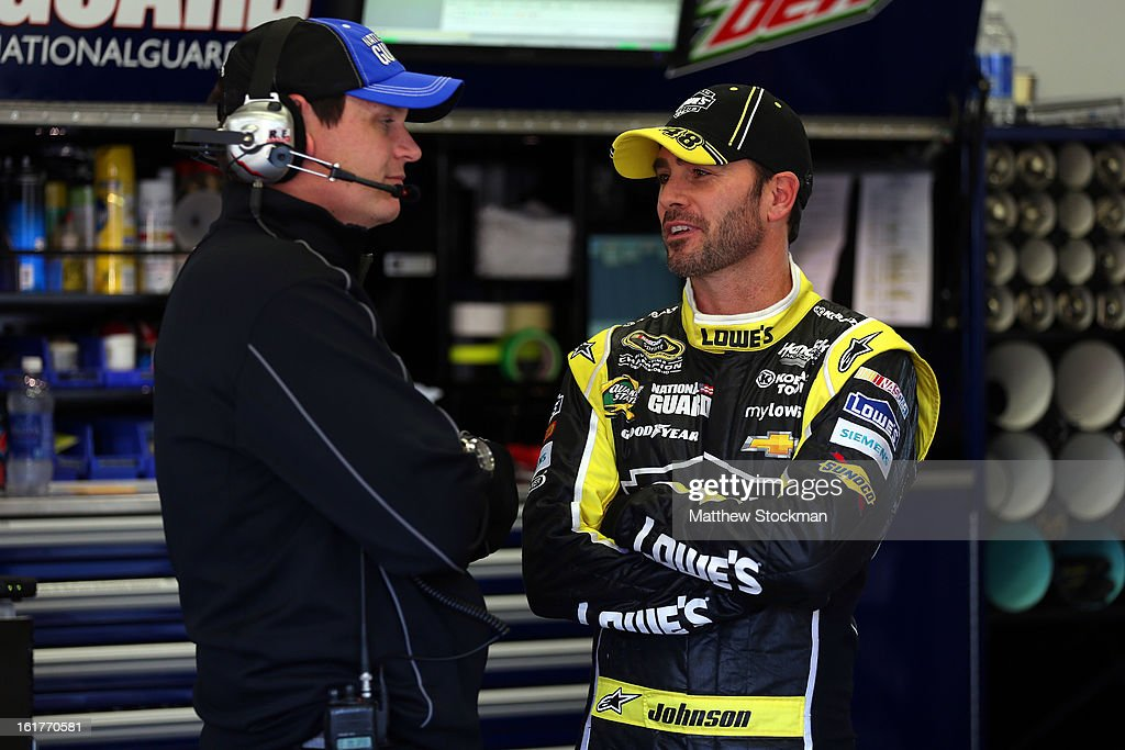 Jimmie Johnson, driver of the #48 Lowe's Yellow Chevrolet, speaks with Steve Letarte, crew chief of the #88 National Guard Chevrolet, during practice for the NASCAR Sprint Cup Series Sprint Unlimited at Daytona International Speedway on February 15, 2013 in Daytona Beach, Florida.