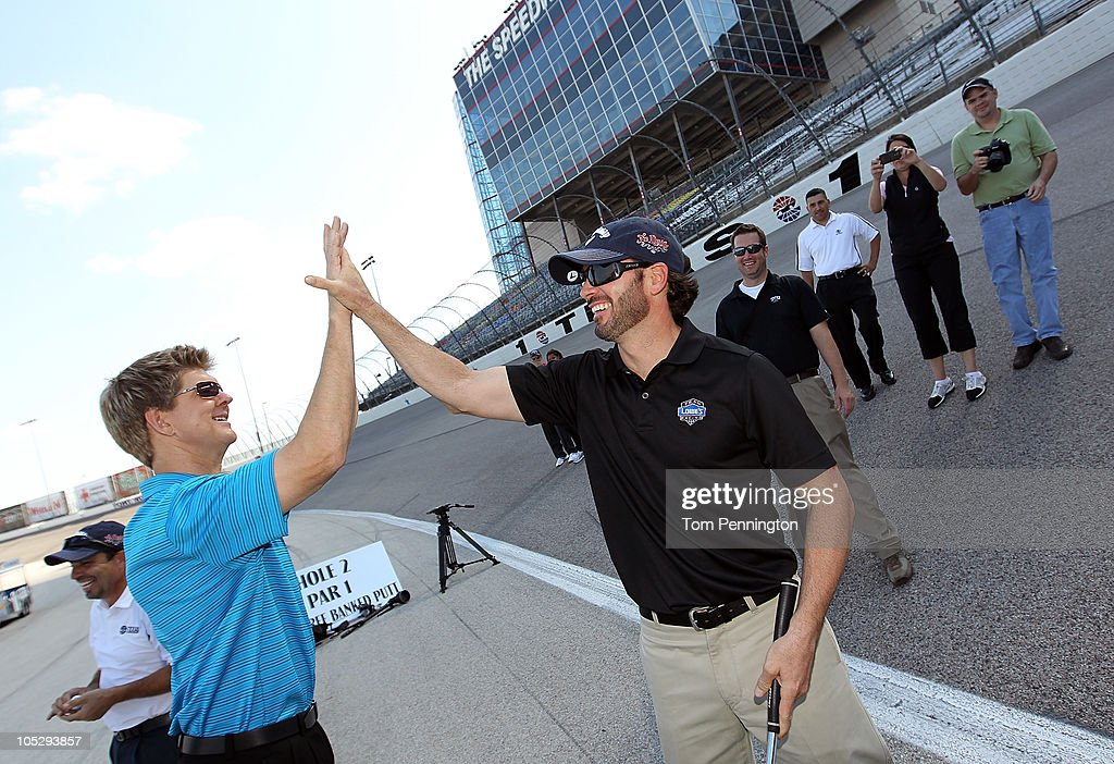 <a gi-track='captionPersonalityLinkClicked' href=/galleries/search?phrase=Jimmie+Johnson+-+Pilota+Nascar&family=editorial&specificpeople=171519 ng-click='$event.stopPropagation()'>Jimmie Johnson</a>, driver of the #48 Lowe's/<a gi-track='captionPersonalityLinkClicked' href=/galleries/search?phrase=Jimmie+Johnson+-+Pilota+Nascar&family=editorial&specificpeople=171519 ng-click='$event.stopPropagation()'>Jimmie Johnson</a> Foundation Chevrolet, celebrates with a member of the media after competing in a putting contest on the 24-degree banking of Turn 1 at Texas Motor Speedway on October 13, 2010 in Fort Worth, Texas.