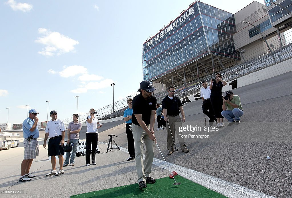 <a gi-track='captionPersonalityLinkClicked' href=/galleries/search?phrase=Jimmie+Johnson+-+Pilota+Nascar&family=editorial&specificpeople=171519 ng-click='$event.stopPropagation()'>Jimmie Johnson</a>, driver of the #48 Lowe's/<a gi-track='captionPersonalityLinkClicked' href=/galleries/search?phrase=Jimmie+Johnson+-+Pilota+Nascar&family=editorial&specificpeople=171519 ng-click='$event.stopPropagation()'>Jimmie Johnson</a> Foundation Chevrolet, competes in a putting contest against members of the media and J.J. Henry, PGA Tour Pro, on the 24-degree banking of Turn 1 at Texas Motor Speedway on October 13, 2010 in Fort Worth, Texas.