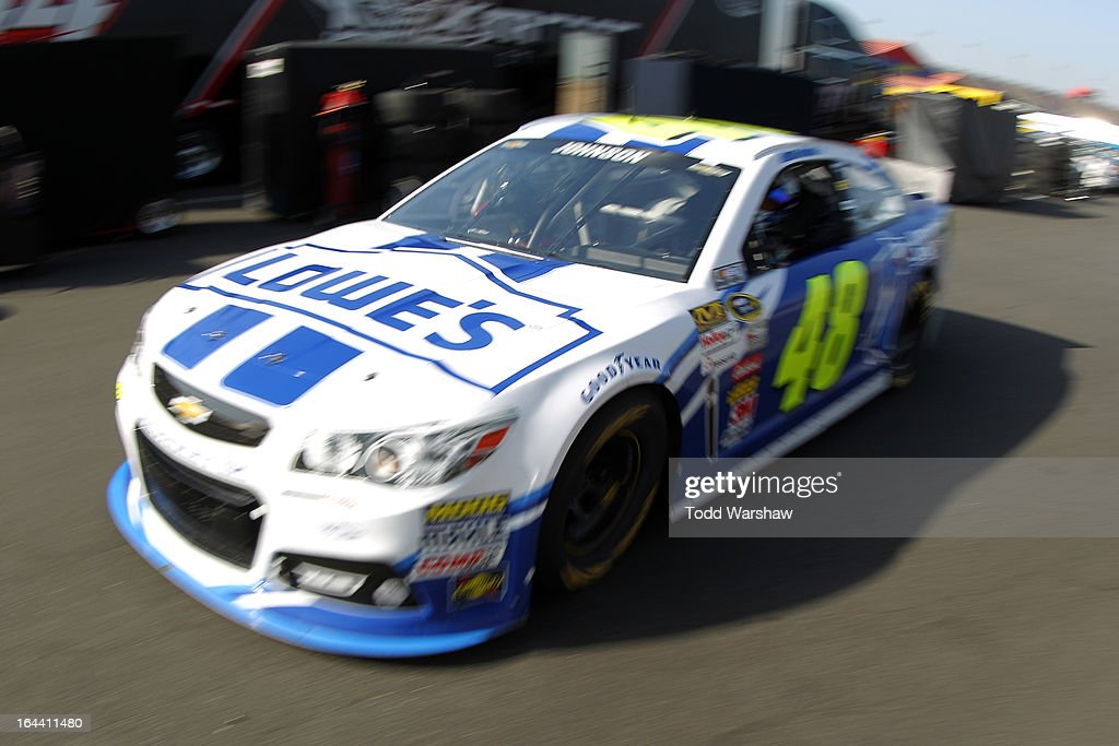 Jimmie Johnson, driver of the #48 Lowe's/Jimmie Johnson Foundation Chevrolet, drives to the garage area during practice for the NASCAR Sprint Cup Series Auto Club 400 at Auto Club Speedway on March 23, 2013 in Fontana, California.