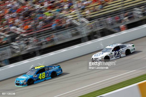 Jimmie Johnson driver of the Lowe's/Jimmie Johnson Foundation Chevrolet leads Corey LaJoie driver of the JAS Expedited Trucking Toyota during the...