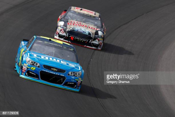 Jimmie Johnson driver of the Lowe's/Jimmie Johnson Foundation Chevrolet leads Ricky Stenhouse Jr driver of the Go Bowling Ford during the Monster...