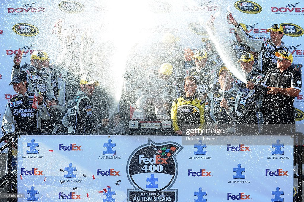 Jimmie Johnson, driver of the #48 Lowe's/Kobalt Tools Chevrolet, and his team celebrate by spraying champagne in Victory Lane after winning the NASCAR Sprint Cup Series FedEx 400 Benefiting Autism Speaks at Dover International Speedway on June 1, 2014 in Dover, Delaware.