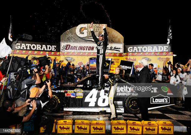 Jimmie Johnson driver of the Lowe's/Kobalt Tools Chevrolet celebrates in Victory Lane after winning the NASCAR Sprint Cup Series Bojangles' Southern...