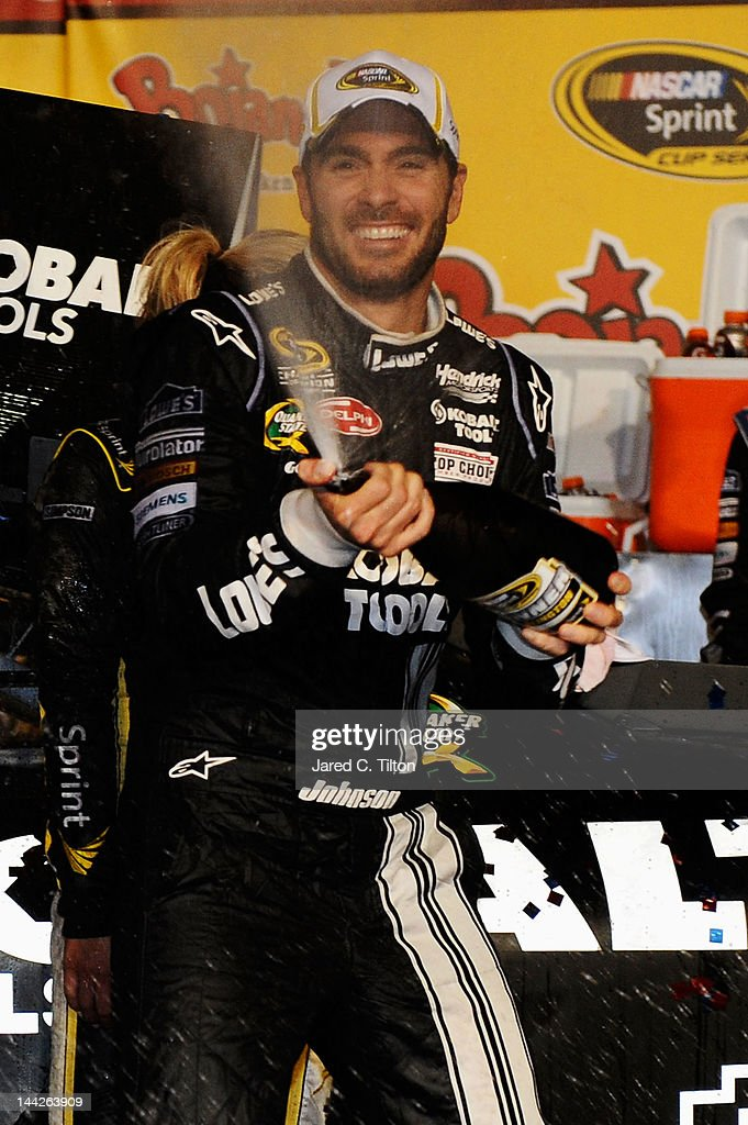 <a gi-track='captionPersonalityLinkClicked' href=/galleries/search?phrase=Jimmie+Johnson+-+Nascar+Race+Driver&family=editorial&specificpeople=171519 ng-click='$event.stopPropagation()'>Jimmie Johnson</a>, driver of the #48 Lowe's/Kobalt Tools Chevrolet, celebrates in Victory Lane after winning the NASCAR Sprint Cup Series Bojangles' Southern 500 at Darlington Raceway on May 12, 2012 in Darlington, South Carolina. This is the 200th win for Hendrick Motorsports.