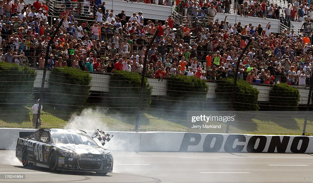 Jimmie Johnson, driver of the #48 Lowe's/Kobalt Tools Chevrolet, celebrates with a burnout after winning the NASCAR Sprint Cup Series Party in the Poconos 400 at Pocono Raceway on June 9, 2013 in Long Pond, Pennsylvania.